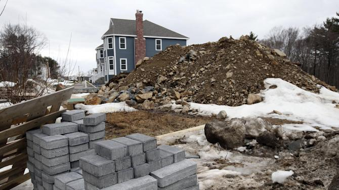 In this Friday, March 21, 2014, photo, a single family housing construction is underway in North Andover, Mass. The Commerce Department reports on U.S. construction spending in February on Tuesday, April 1, 2014. (AP Photo/Elise Amendola)