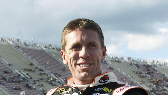 Carl Edwards gives a thumbs-up after qualifying for the NASCAR Sprint Cup Series auto race at Michigan International Speedway on Friday, Aug. 17, 2012, in Brooklyn, Mich. Edwards took second spot in qualifications. (AP Photo/Bob Brodbeck)