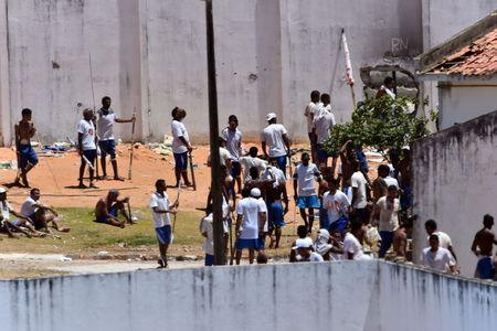 Inmates are seen during an uprising at Alcacuz prison in Natal