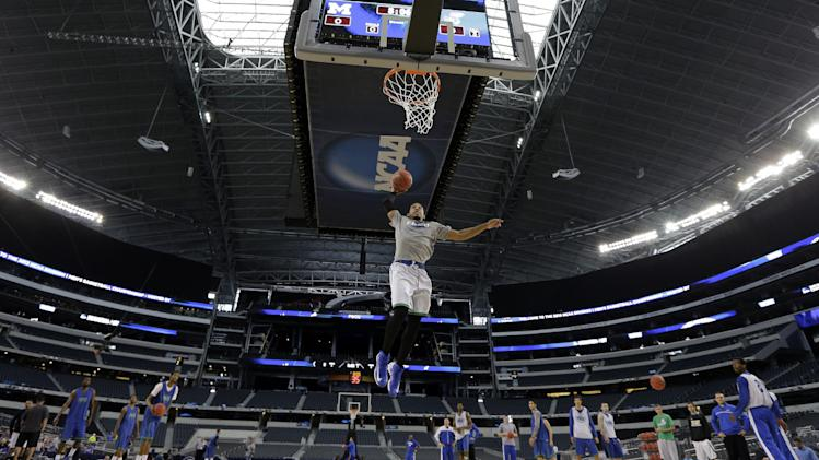 Florida Gulf Coast's Sherwood Brown dunks during practice for a regional semifinal game in the NCAA college basketball tournament, Thursday, March 28, 2013, in Arlington, Texas. Florida Gulf Coast faces Florida on Friday. (AP Photo/David J. Phillip)