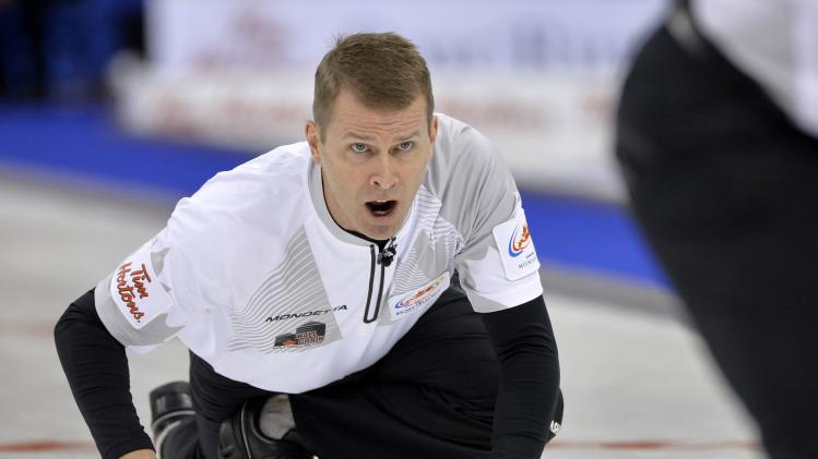 Skip Jeff Stoughton yells to his sweepers during the game against Team Koe at the Roar of the Rings Canadian Olympic Curling Trials in Winnipeg