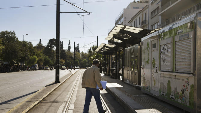 A man walks at a deserted tram stop in central Athens during a strike of the metro and tram networks, in central Athens, Friday, Nov. 9, 2012. Cash-strapped Greece will issue short term debt on Tuesday in the hope of raising enough money to repay a key bond days later. Greece is not expected to get its next batch of international rescue loans by Nov. 16, when it has to roll over euro5 billion in three-month treasury bills. (AP Photo/Dimitri Messinis)