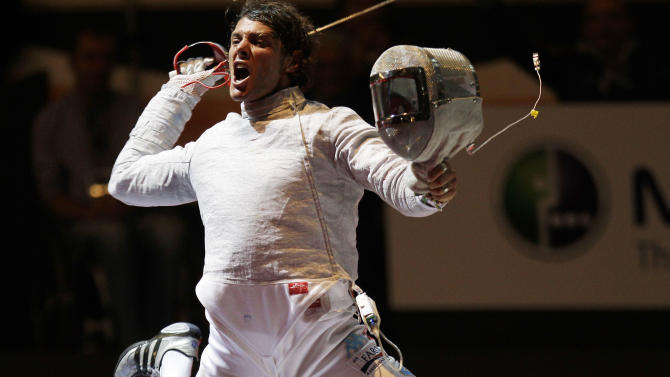 Italy's Aldo Montano celebrates after winning against Korea's Bon Gil Gu during a men's individual sabre, semifinal match, at the World Fencing Championship in Catania, Italy, Tuesday, Oct. 11, 2011. (AP Photo/Antonio Calanni)
