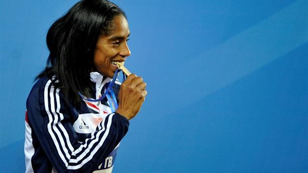 Yamile Aldama of Britain bites her gold medal during the awards ceremony for the women&#39;s Triple Jump at the world indoor athletics championships at the Atakoy Athletics Arena in Istanbul