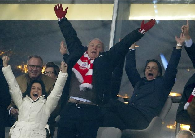 Bayern Munich's president Hoeness and chief executive Rummenigge celebrate during the Champions League round of 16 second leg soccer match between against Arsenal in Munich