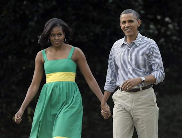 "FILE - In this June 27, 2012 file photo, President Barack Obama and his wife, Michelle, arrive at the Congressional picnic on the South Lawn of the White House in Washington. The Democratic president and first lady will tape an episode of ""The View"" on Monday, Sept. 20, 2012 to air the next day, in their first joint appearance on the daytime show. GOP challenger Mitt Romney might not be far behind. (AP Photo/Susan Walsh, File)"
