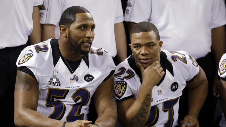 Baltimore Ravens linebacker Ray Lewis (52) talks to Ray Rice during media day for the NFL Super Bowl XLVII football game Tuesday, Jan. 29, 2013, in New Orleans. (AP Photo/Mark Humphrey)
