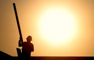 <p> In this Thursday, June 27, 2013, photo, a construction worker is shown atop a roof at sunrise to beat daytime high temperatures in Queen Creek, Ariz. The Commerce Department releases housing starts for June on Tuesday, July 16, 2013. (AP Photo/Matt York)