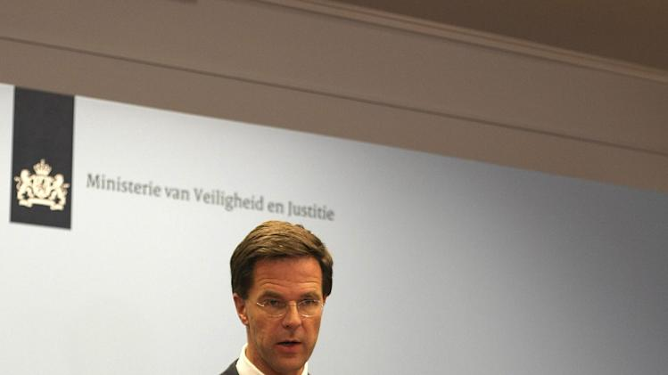 "Dutch Prime Minister Mark Rutte speaks at a press conference in The Hague, Netherlands, Thursday, July 24, 2014. Rutte says he is sending 40 unarmed military police to eastern Ukraine as part of a ramped-up effort to find the last victims of the downing of Malaysia Airlines Flight 17 still at the crash site. Rutte told The Associated Press he is sending the police not as security for the site in rebel-held territory but as ""extra hands and eyes to look for remaining remains and personal belongings"" of victims. (AP Photo/Mike Corder)"