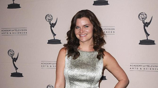 FILE - In this Thursday, June 13, 2013 photo, Heather Tom arrives at the 40th Annual Daytime Emmy Awards nominee reception at the Montage Beverly Hills, in Beverly Hills, Calif. The 40th Annual Daytime Emmy Awards are on Sunday, June 16, 2013, in Beverly Hills, Calif. (Photo by Scott Kirkland/Invision/AP, File)