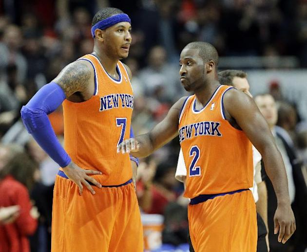 New York Knicks forward Carmelo Anthony, left, and guard Raymond Felton react after Anthony missed a last goal during the second half of an NBA basketball game against the Chicago Bulls in Chicago, Th