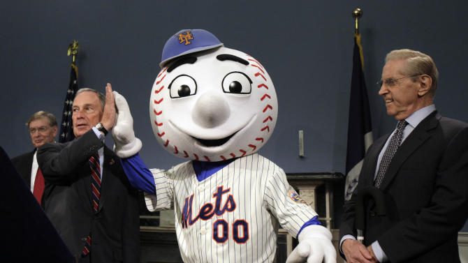 New York Mayor Michael Bloomberg, second from left, high-fives Mr. Met as Major League Baseball Commissioner Bud Selig, left, and New York Mets owner Fred Wilpon, right, look on after it was announced that the 2013 All-Star game will be hosted by the Mets at Citi Field, during a news conference at New York's City Hall,  Wednesday, May 16, 2012. The Mets last hosted the All-Stars in 1964, the year Shea Stadium opened. (AP Photo/Richard Drew)