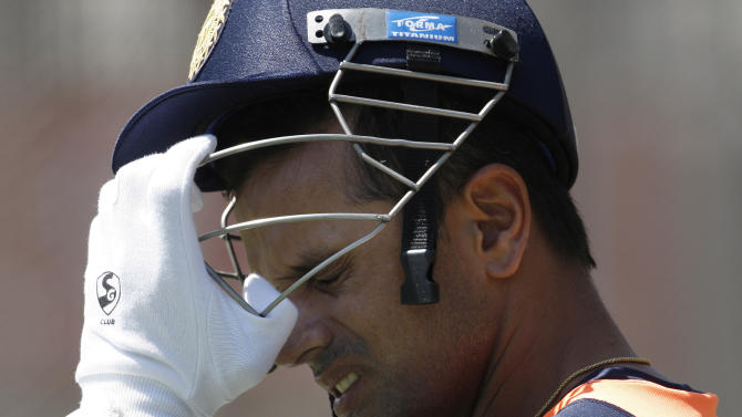 Rahul Dravid of India adjusts his helmet in the nets during the team's training at the MCG in Melbourne, Australia, Friday, Dec. 23, 2011. (AP Photo/David Callow)