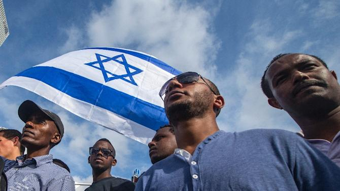 Israelis take part in a demonstration in Tel Aviv called by members of the Ethiopian community against alleged police brutality and institutionalised discrimination, on May 3, 2015