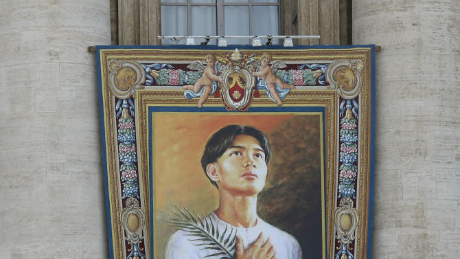 The tapestry of Pedro Calungsod, of the Philippines, hangs from the St. Peter's Basilica, at the Vatican, Friday, Oct. 19, 2012. Calungsod will be declared a saint along with six others in a ceremony presided over by Pope Benedict XVI at the Vatican on Sunday. (AP Photo/Alessandra Tarantino)