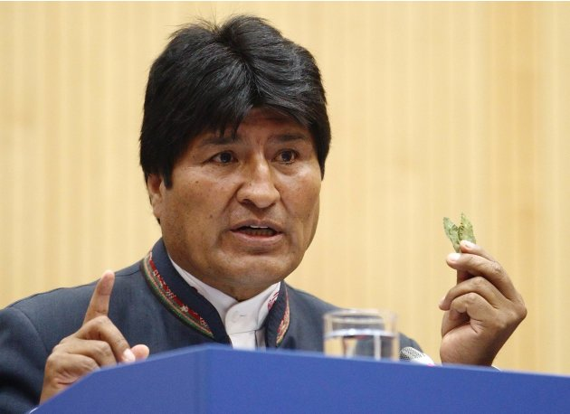 Bolivia's President Morales displays coca leaves as he delivers speech during UNODC conference at the U.N. headquarters in Vienna