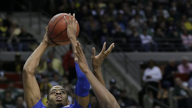 Memphis forward D.J. Stephens (30) shoots over Michigan State forward Adreian Payne in the first half of their third-round game of the NCAA college basketball tournament in Auburn Hills, Mich., Saturday March 23, 2013.  (AP Photo/Paul Sancya)