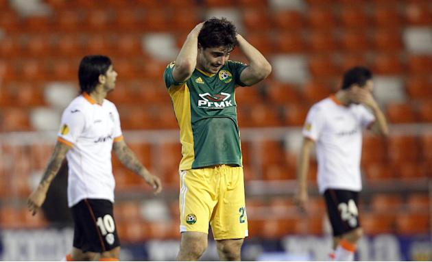 Kuban Krasnodar's Anton Sosnin reacts at the end their Europa  League Group A soccer against Valencia match at the Mestalla stadium in Valencia, Spain, Thursday, Dec. 12, 2013