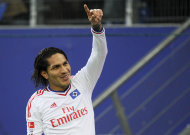 Hamburg's Paolo Guerrero celebrates a goal during the German Bundesliga soccer match between SV Hamburg and 1. FC Nuremberg in Hamburg, northern Germany, Sunday Dec. 4, 2011. (AP Photo/dapd/ Axel Heimken) NO MOBILE USE UNTIL 2 HOURS AFTER THE MATCH, WEBSITE USERS ARE OBLIGED TO COMPLY WITH DFL-RESTRICTIONS, SEE INSTRUCTIONS FOR DETAILS