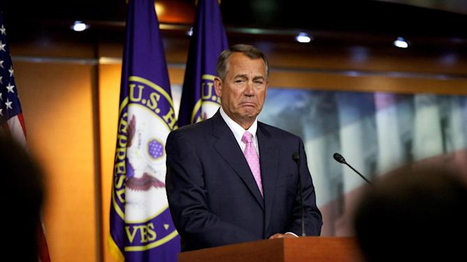 "House Speaker John Boehner of Ohio listens to a reporter's question during a news conference in the U.S. Capitol in Washington, Thursday, Nov. 14, 2013. Speaking about the Affordable Care Act, Boehner insisted it was time to ""scrap this law once and for all."" (AP Photo/Molly Riley)"