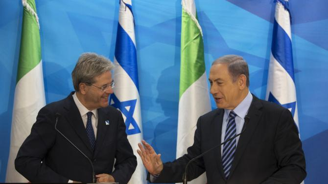 Israeli Prime Minister Netanyahu gestures as he speaks with Italian Foreign Minister Gentiloni during their meeting in Jerusalem