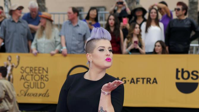 Kelly Osbourne arrives at the 21st annual Screen Actors Guild Awards in Los Angeles