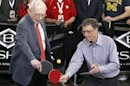 Berkshire Hathaway CEO Warren Buffett plays table tennis with Microsoft Chairman Bill Gates in Omaha