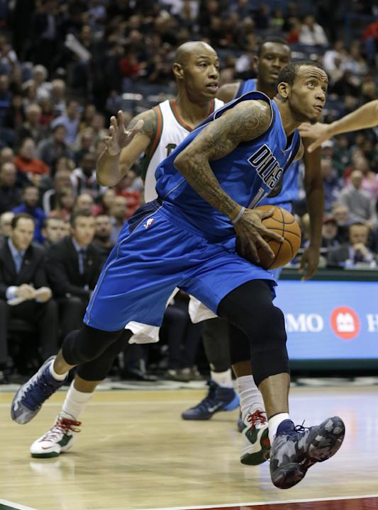 Dallas Mavericks' Monta Ellis, right, drives past Milwaukee Bucks' Caron Butler during the first half of an NBA basketball game Saturday, Nov. 9, 2013, in Milwaukee