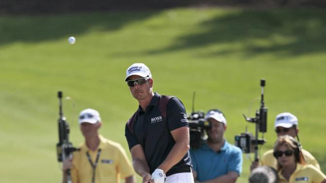 Stenson of Sweden plays a shot onto the third green during the third round of the DP World Tour Championship in Dubai