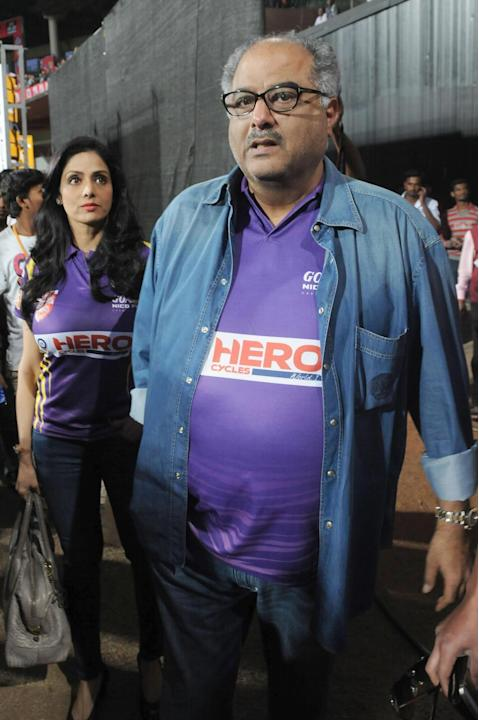 Film producer Boney Kapoor and his wife actress Sridevi during a Celebrity Cricket League match between Bengal Tigers and Karnataka Bulldozers at Chinnaswamy Stadium in Bangalore on Jan.26, 2014. (Pho