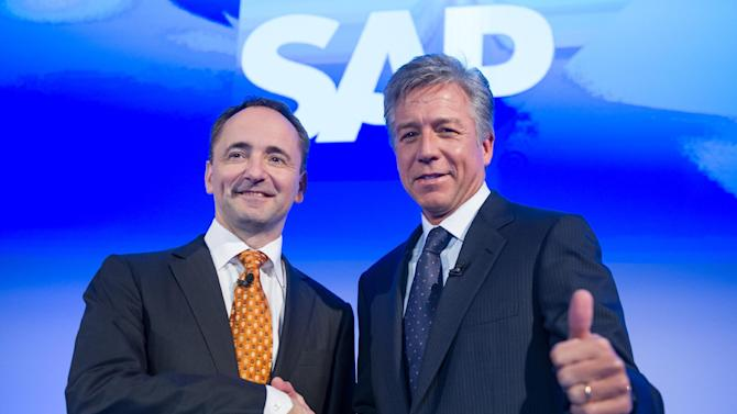 """FILE - In this  Jan. 23, 2013 file picture CEOs Jim Hagemann Snabe and Bill McDermott, right, pose for photographers prior to a press conference in Walldorf, southwestern Germany. The co-CEO of business software maker SAP AG says its push into cloud computing is starting to make money  and could be heading for profits that rival or exceed those of its traditional software business.   Bill McDermott told The Associated Press Friday April 19, 2013  that """"we accelerated into the cloud in a big way about a year ago and already we're making money on it.""""  (AP Photo/dpa, Uwe Anspach, File)"""