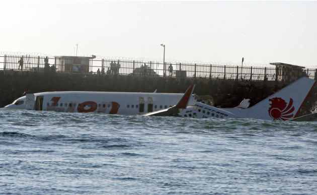 The wreckage of a Lion Air jet sits in the ocean near the airport in Bali, Indonesia on Sunday, April 14, 2013. All 108 passengers and crew survived after the new Lion Air jet crashed into the ocean a