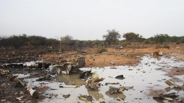 Debris is seen at the crash site of Air Algerie flight AH5017 near the northern Mali town of Gossi