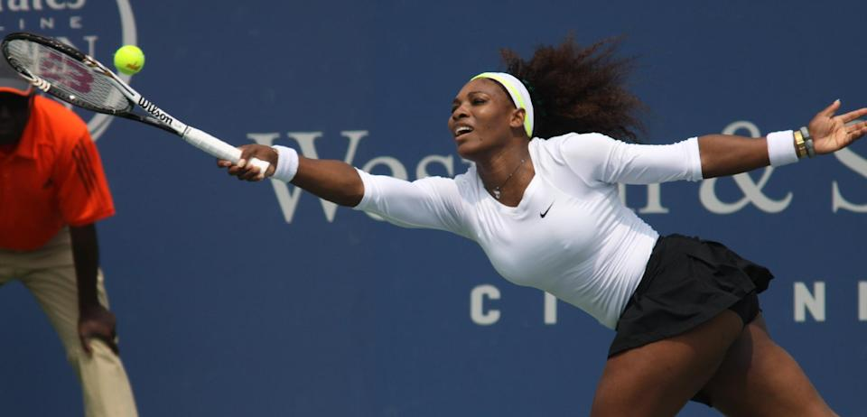 Serena Williams, of the United States, returns a volley to Urszula Radwanska, of Poland, during a match at the Western & Southern Open tennis tournament, Thursday Aug. 16, 2012, in Mason, Ohio. (AP Photo/Tom Uhlman)