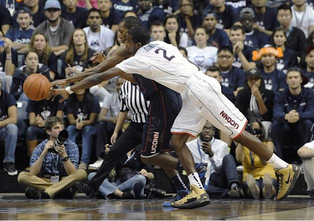 Connecticut's Lasan Kromah, left, and DeAndre Daniels, right, chase a loose ball during an inter-squad scrimmage at the men's and women's basketball teams' First Night event in Friday, Oct. 18, 2013,