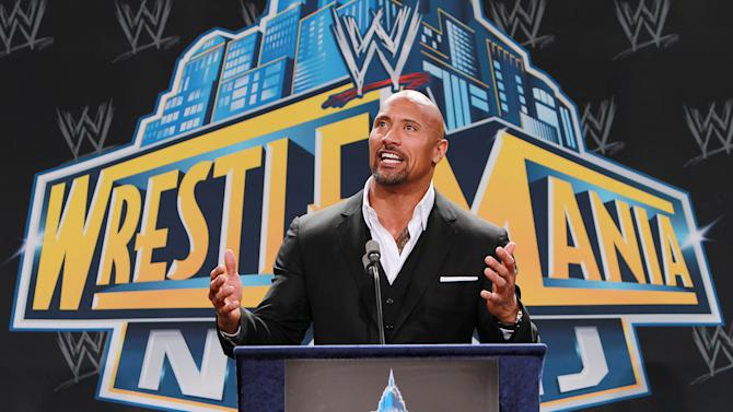 """FILE - In this Feb. 16, 2012 file photo, World Wrestling Entertainment personality Dwayne """"The Rock"""" Johnson speaks at a news conference in East Rutherford, N.J. The Rock is ready to roll into WrestleMania a double champion. He's king of the box office after """"G.I. Joe: Retaliation"""" took in $40.5 million over the weekend to become the No. 1 movie. He stands atop World Wrestling Entertainment as the promotion's champ heading into Sunday's April 7, 2013  WrestleMania.  (AP Photo/StarPix, Dave Allocca, File)"""