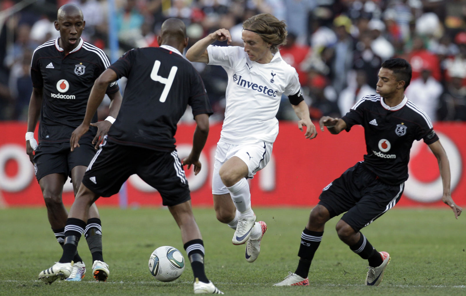 luka modric second from right attacks as orlando pirates players