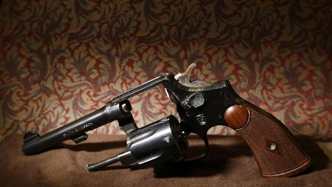 This Wednesday, March 25, 2015 photo shows a Smith & Wesson .38 Special in Mountainside, N.J. The gun belonged to IRS investigator Michael Malone, the man who went undercover to infiltrate Al Capone's gang in the 1930s and eventually brought down the feared mobster. (AP Photo/Julio Cortez)