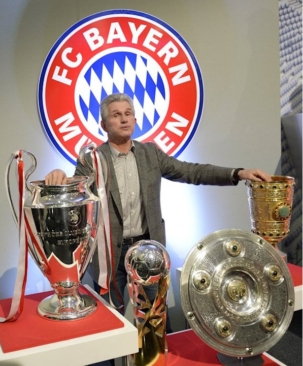 Outgoing Bayern coach Jupp Heynckes with his haul of trophies after giving his farewell press conference on June 4, 2013