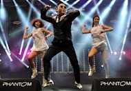 "Psy (L) performs his hit single ""Gangnam Style"" during a concert in Istanbul on February 22, 2013. The South Korean singer is promising a ""Psy style"" take on a traditional Korean dance to accompany the release next week of the highly-anticipated follow-up to ""Gangnam Style"""