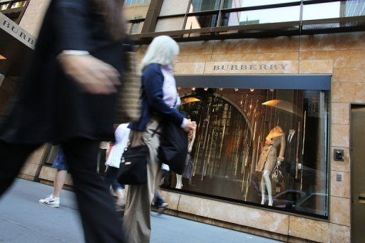 &lt;p&gt;People walk by a Burberry store in Manhattan on September 12. US consumer confidence rebounded sharply this month after a plunge in August, the Conference Board said Tuesday in its monthly survey release.&lt;/p&gt;