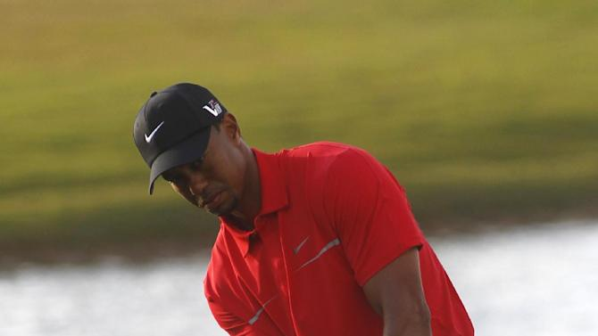 Tiger Woods hits from the rough on the 18th holde during the third round of the Cadillac Championship golf tournament Sunday, March 10, 2013, in Doral, Fla. Woods won the  Cadillac Championship with a score 19-under-par 269. (AP Photo/Marta Lavandier)
