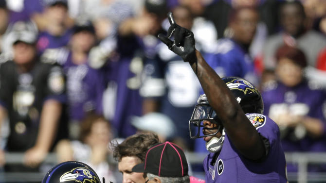 Baltimore Ravens wide receivers Torrey Smith, left, and Anquan Boldin react after Smith's touchdown in the first half of an NFL football game against the Dallas Cowboys in Baltimore, Sunday, Oct. 14, 2012. (AP Photo/Patrick Semansky)