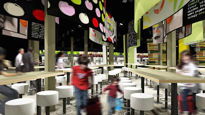 "This undated computer generated image taken from McDonald's website shows the interior of the London 2012 Olympics-McDonald's Central Restaurant in London.  British doctors have slammed the sponsorship of the London Olympics by companies like McDonalds, saying it sends the wrong message amid the country's ballooning obesity crisis. Big Macs, fries and milkshakes will be part of McDonald's exclusive ""meal brand"" of the Olympics and the fast-food giant will soon be opening its largest franchise in the world, a two-storey cathedral-like restaurant that seats 1,500 customers, at London's Olympic Park. (AP Photo/Website McDonald's London 2012 Olympic Summer Games)"