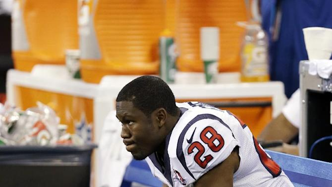 Houston Texans' Justin Forsett (28) watches from the bench late in the second half of an NFL football game against the Indianapolis Colts, Sunday, Dec. 30, 2012, in Indianapolis. The Colts won the game 28-16. (AP Photo/Michael Conroy)