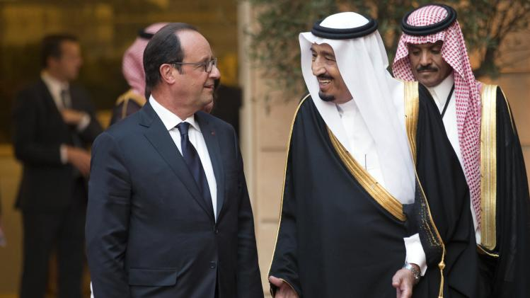 French President Francois Hollande and Saudi Crown Prince Salman bin Abdulaziz al-Saud talk before a dinner at the Elysee Palace in Paris