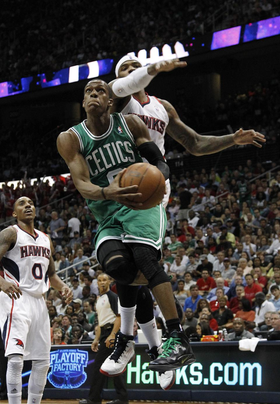 Boston Celtics point guard Rajon Rondo (9) drives as Atlanta Hawks power forward Josh Smith (5) defends during the second  half of Game 5 of an NBA first-round playoff series basketball game Tuesday, May 8, 2012, in Atlanta. (AP Photo/John Bazemore)