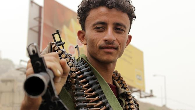 A supporter of the Shiite Huthi militia takes part in a demonstration in Yemen's second larget city of Taez on April 3, 2015, to protest against the Saudi-led coalition''s Operation Decisive Storm against the rebels in Yemen