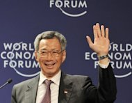 Singaporean Prime Minister Lee Hsien-Loong is seen at the World Economic Forum (WEF) on East Asia in Jakarta in 2011. Singapore is to slash its leaders&#39; unpopular multi-million-dollar salaries by at least a third, but they will remain the world&#39;s best-paid politicians