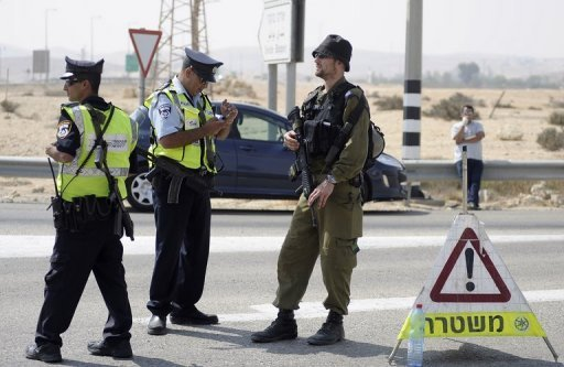 Israeli policemen and a soldier guard a checkpoint in the Negev desert as they look for militants who infiltrated the Egyptian border in June 2012. Israeli troops have shot dead three heavily armed gunmen who sneaked across the Egyptian border and ambushed troops, averting &quot;a very big terror attack,&quot; a military spokeswoman told AFP